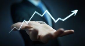 Бизнесмен держа нарисованную вручную стрелку идя вверх Стоковые Изображения RF