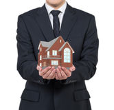 Бизнесмен держа дом Стоковая Фотография