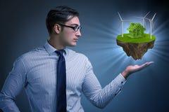 Бизнесмен держа остров летания в концепции eco Стоковое Изображение RF