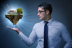 Бизнесмен держа остров летания в концепции eco Стоковое Изображение