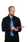 Бизнесмен держа папку и ручку Стоковые Изображения