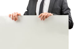 Бизнесмен держа пустой знак Стоковое фото RF