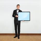 Бизнесмен держа плазму Стоковые Фотографии RF