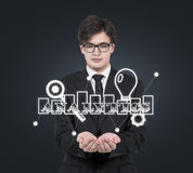 Бизнесмен держа символ аналитика Стоковые Фотографии RF
