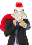 Бизнесмен держа сумку и деньги подарка рождества стоковая фотография rf