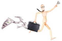 Бизнесмен держа случай с деньгами Стоковое Изображение