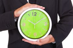 Бизнесмен держа часы Стоковая Фотография RF