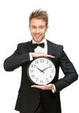 Бизнесмен держа часы Стоковые Фотографии RF