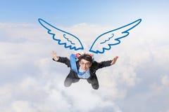 Бизнесмен летая высоко стоковая фотография rf