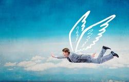 Бизнесмен летая высоко стоковое изображение rf