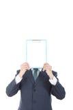Бизнесмен задерживая знамя против белого inst предпосылки Стоковое Фото