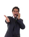 Бизнесмен злющий о работе Стоковое фото RF