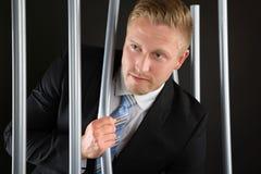 Бизнесмен избегая от тюрьмы Стоковое фото RF