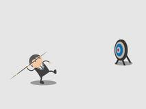 Бизнесмен имеет javelin trow, который нужно прицелиться по мере того как бизнесмен имеет цель сделать Abstra персонажа из мультфи Стоковое фото RF