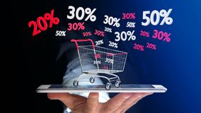 Бизнесмен используя smartphone с красной и белой вагонеткой и Стоковые Изображения RF