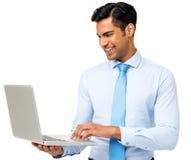 Бизнесмен используя компьтер-книжку стоковые изображения