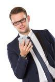 Бизнесмен используя сотрясенный мобильный телефон, стоковые фото