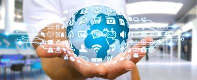 Бизнесмен используя цифровой мир с значками сети Стоковые Изображения