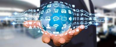 Бизнесмен используя цифровой мир с значками сети Стоковые Фото