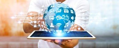 Бизнесмен используя цифровой мир с значками сети Стоковая Фотография RF