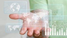 Бизнесмен используя цифровые диаграммы летания и бары взаимодействуют Стоковое Фото