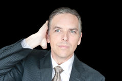 Бизнесмен исправляет волосы стоковая фотография rf
