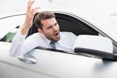 Бизнесмен испытывая раж дороги Стоковые Изображения