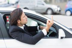 Бизнесмен испытывая раж дороги Стоковое Фото