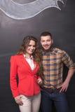 Бизнесмен и женщина в студии Стоковая Фотография RF