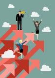 Бизнесмен и женщина стоя на красных диаграммах вверх Стоковое фото RF
