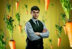 Бизнесмен и моркови Стоковые Изображения