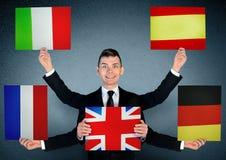 Бизнесмен и доска языков стоковое фото