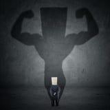 Бизнесмен и сильная тень Стоковые Фотографии RF
