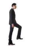 Бизнесмен идя вверх Стоковое Фото