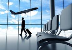 Бизнесмен идя в авиапорт стоковое изображение rf