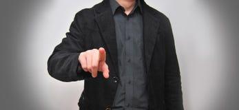 Бизнесмен касающий футуристический экран Стоковые Изображения RF