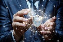 Бизнесмен кладет систему защиты сети Стоковое Изображение