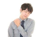 Бизнесмен который имеет боль плеча Стоковые Изображения RF