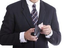 Бизнесмен кладя деньги доллара для оплаты что-то Стоковые Фото