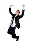 Бизнесмен нажимает вверх что-то Стоковое Изображение