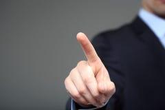 Бизнесмен нажимая бледное в космос Стоковая Фотография RF