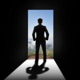 Бизнесмен на двери Стоковая Фотография