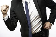 Бизнесмен на движении с сжатыми кулаками Стоковая Фотография