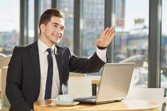 Бизнесмен на кофейне Стоковая Фотография