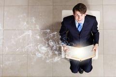 Бизнесмен на стуле Стоковая Фотография