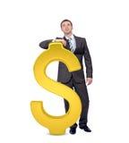 Бизнесмен около большого знака доллара Стоковая Фотография RF