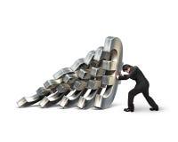 Бизнесмен останавливая падать денег евро Стоковые Изображения RF