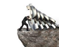 Бизнесмен останавливая понижаясь символы валюты доллара на скале Стоковые Изображения
