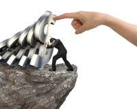 Бизнесмен останавливая понижаясь символы доллара с рукой женщины помогает Стоковая Фотография RF