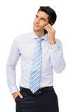 Бизнесмен отвечая умному телефону стоковое фото rf